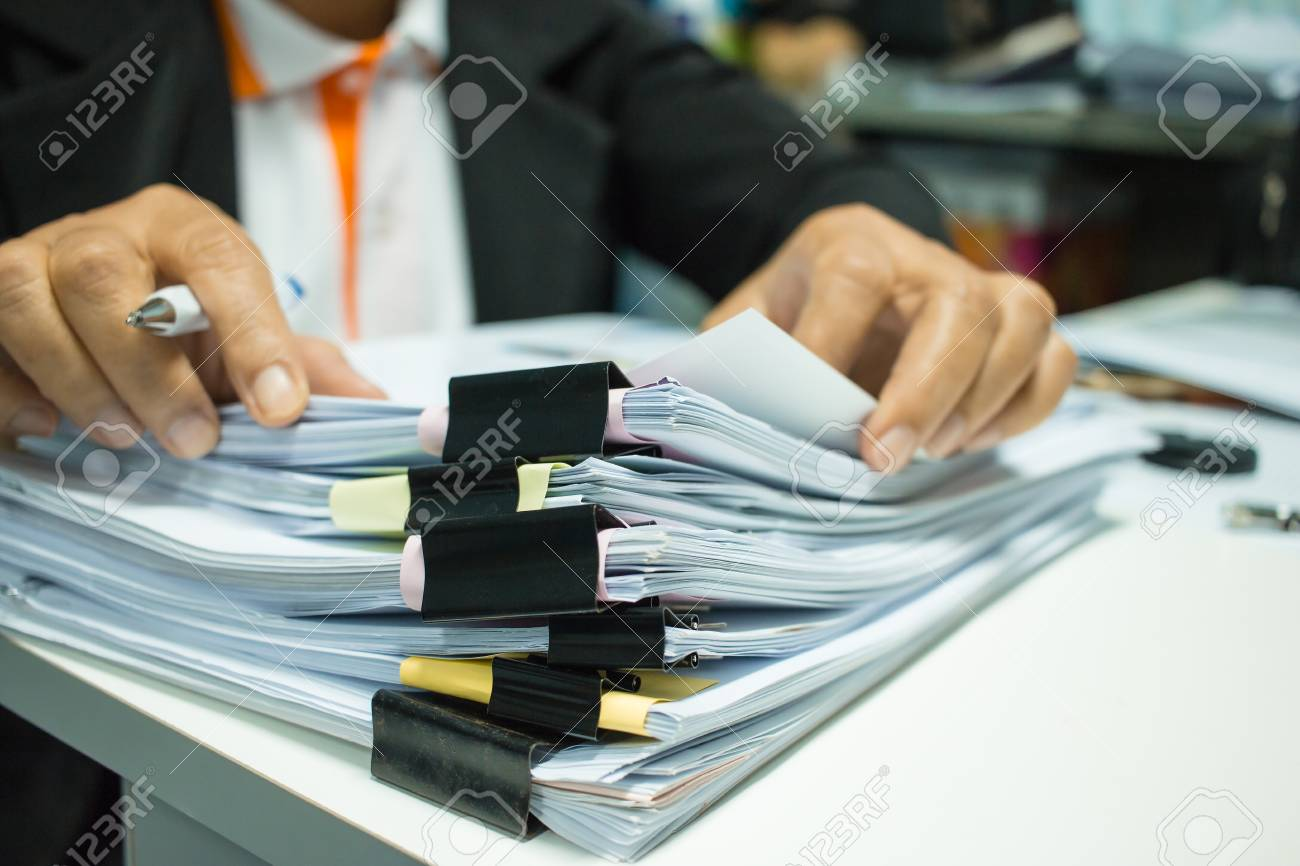 Businesswoman hands working on Stacks of documents files for finance in office. Business report papers or Piles of unfinished document achieves with black clip paper. Concept of Business Annual Report - 92931165