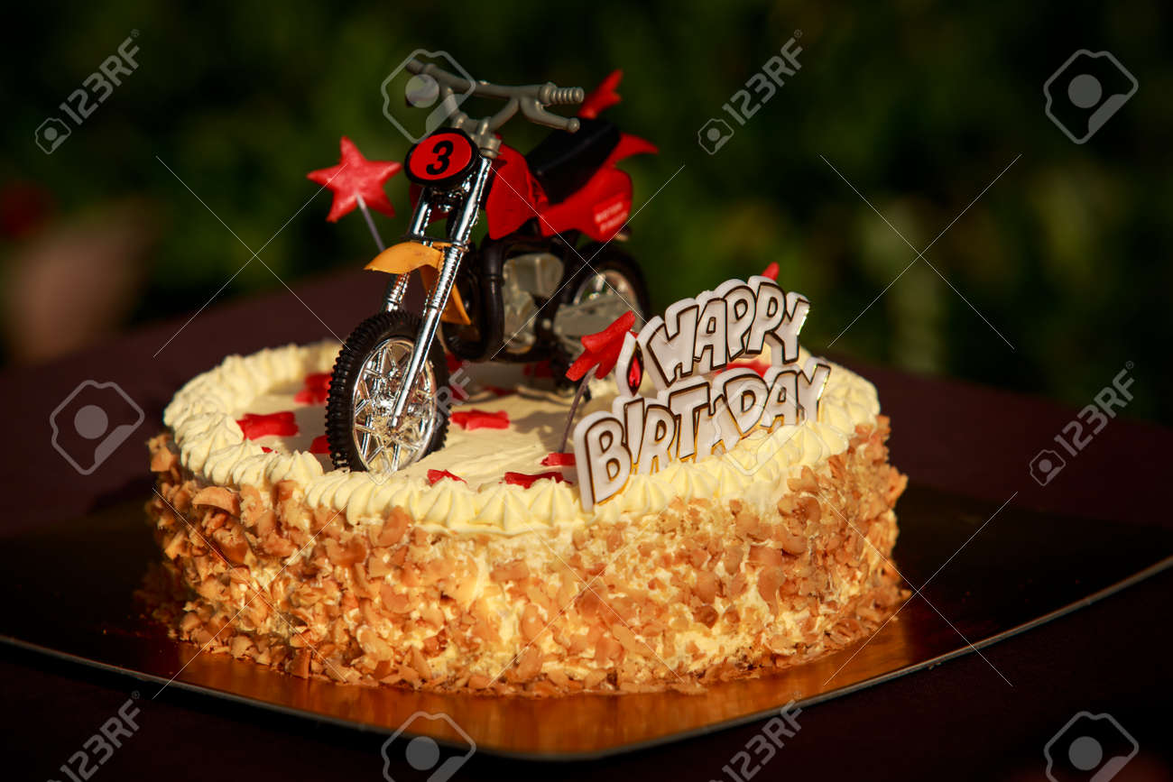 Birthday Cake With Nuts And Vanilla Cream Decorated With Motorcycle