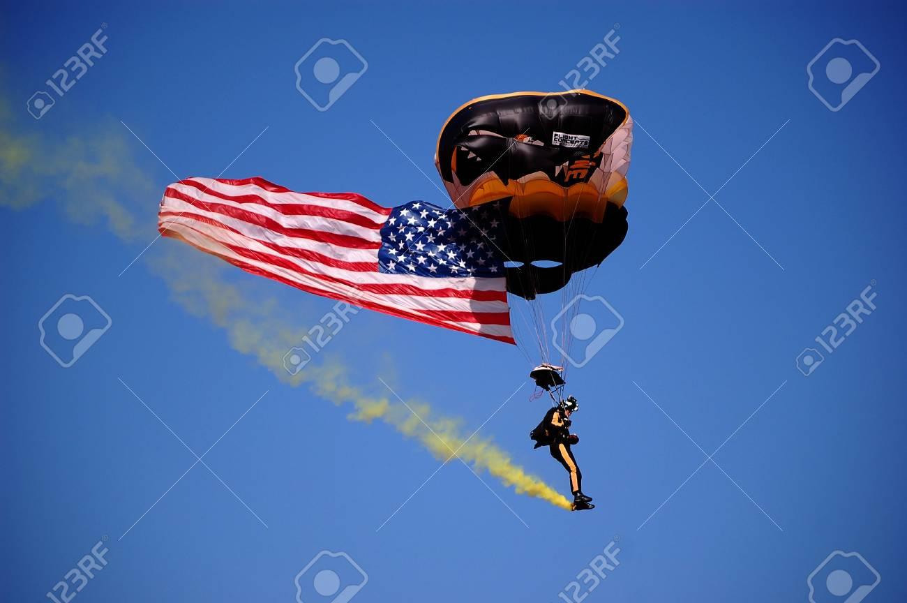 ANN ARBOR, MI - OCTOBER 09: 101st Airborne Division Parachute Demonstration Team member parachutes into Michigan Stadium before the Michigan vs. Michigan State football game October 9, 2010.  Stock Photo - 7960530