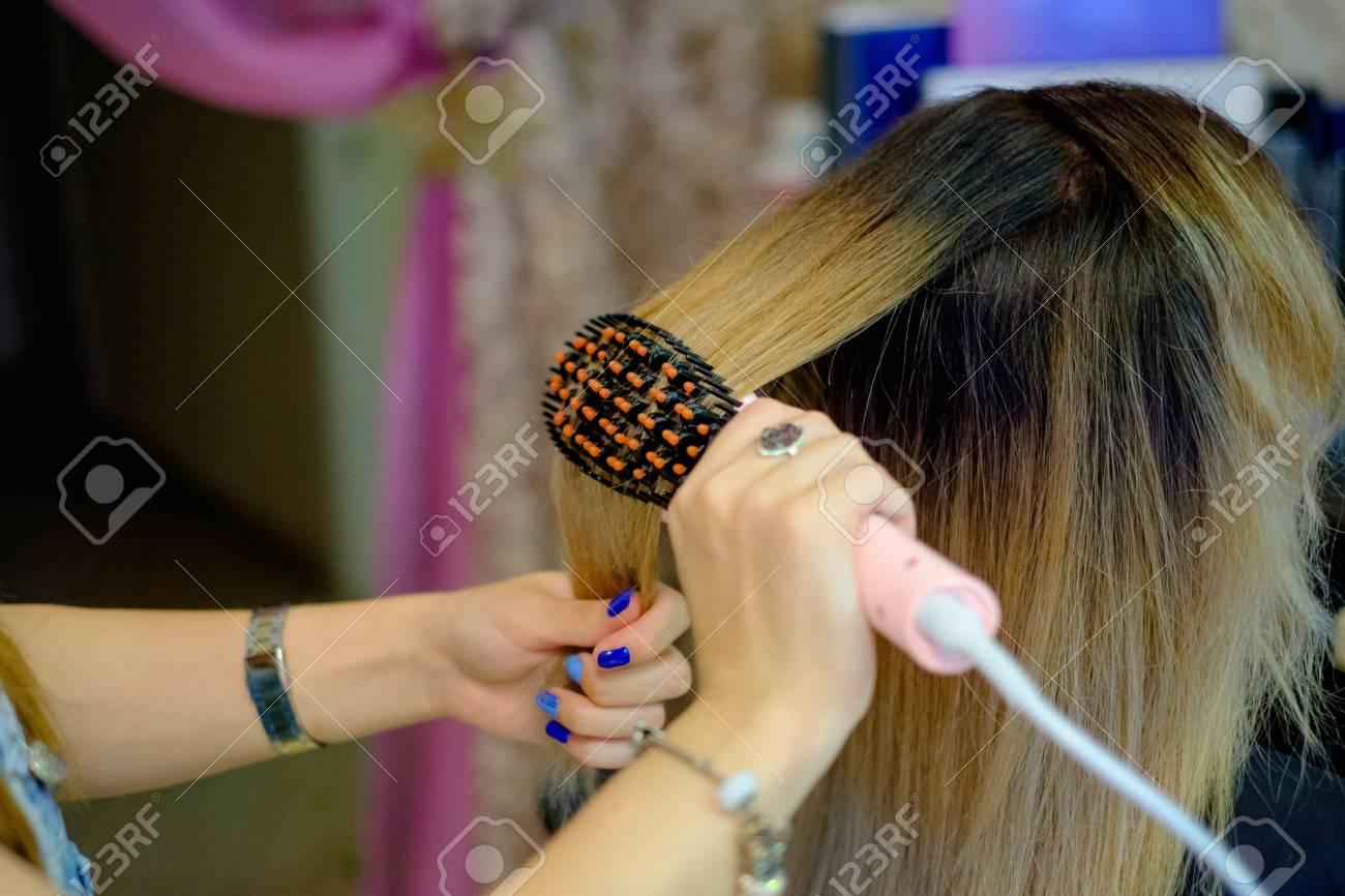Hair Dresser Showing Blonde Female Hair With Bad Hair Extension