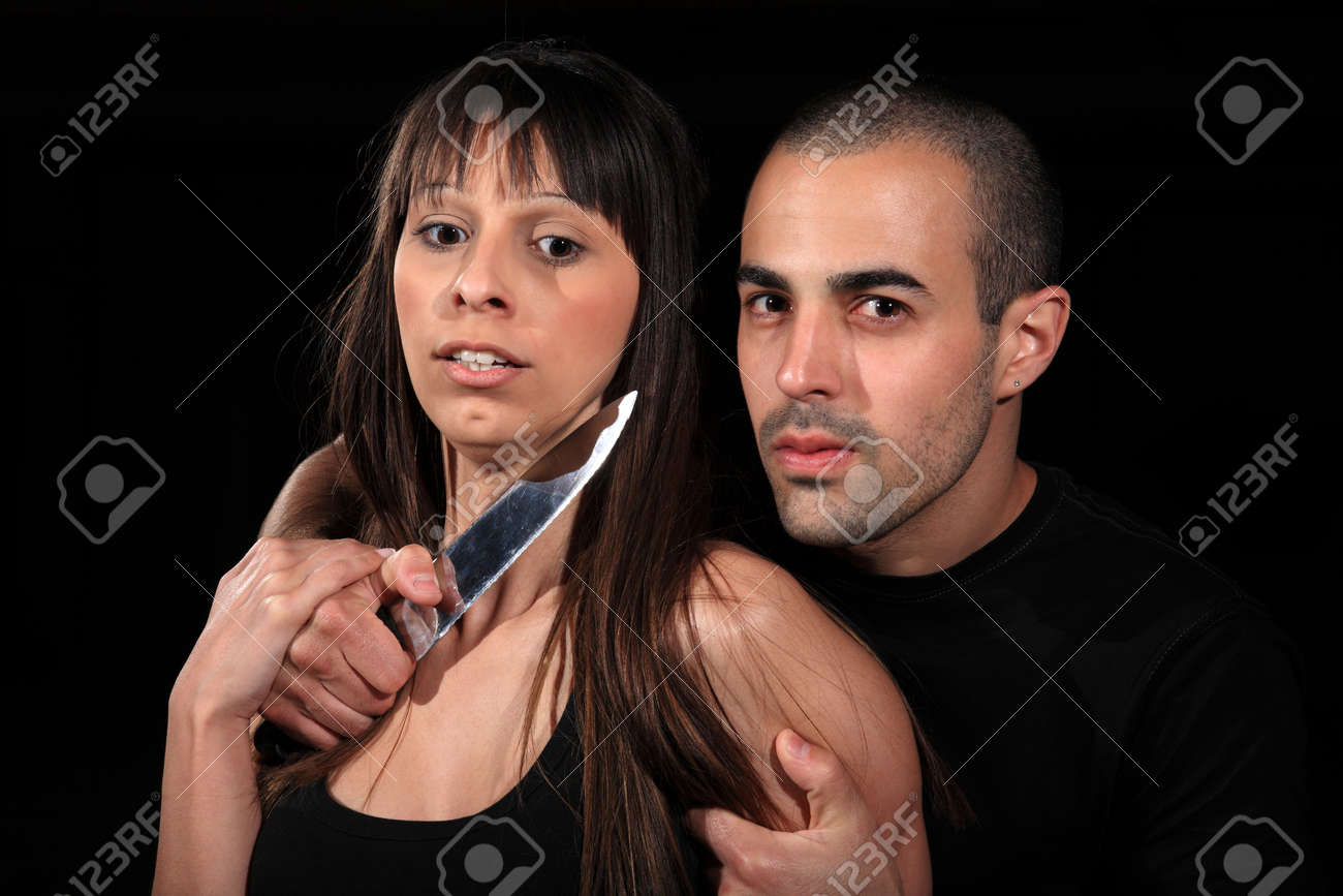 criminal kidnapping a girl with a knife Stock Photo - 13927852