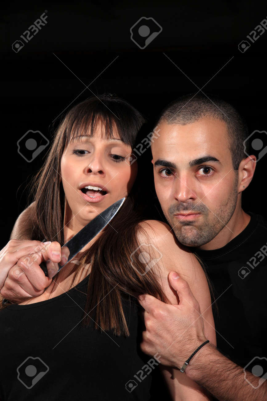 criminal kidnapping a girl with a knife Stock Photo - 13928040