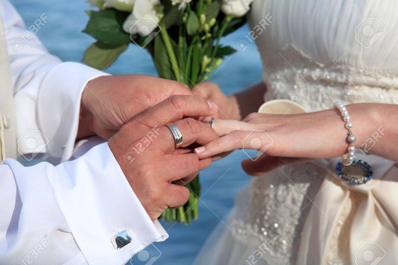 Bride and groom change rings at their wedding Stock Photo - 13927594