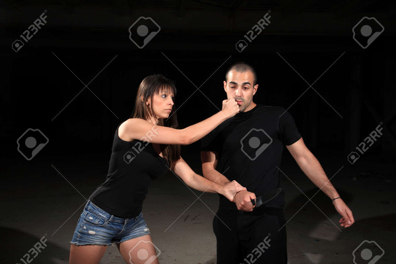 martial arts female instructor exercising with young man Stock Photo - 16741276