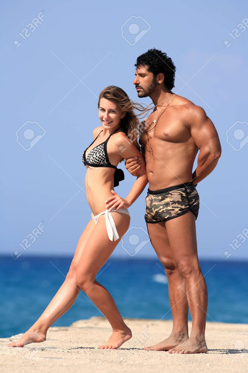 young happy couple posing at the beach Stock Photo - 16748402