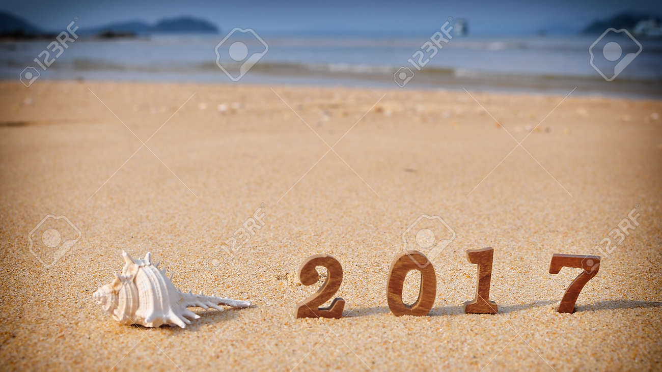 stock photo wood number 2017 on tropical beach happy new year concept and coral decorative idea
