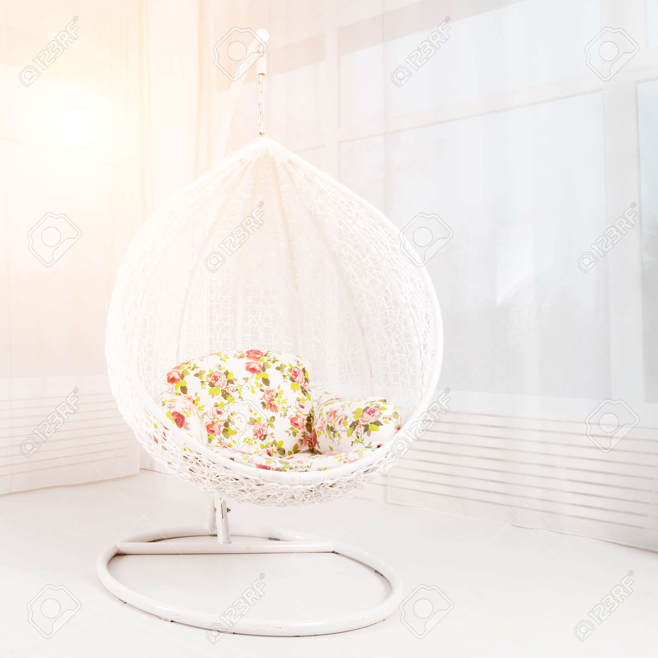 Image of: White Round Chair With Flowers In A Light Large Living Room Stock Photo Picture And Royalty Free Image Image 104893928