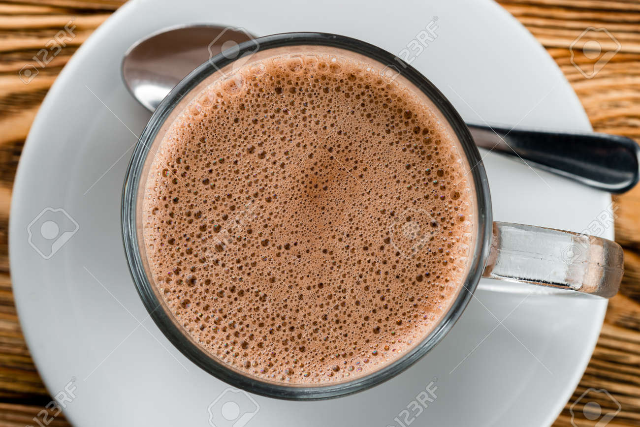 hot chocolate with frothy foam, texture of cocoa hot chocolate in a mug top view closeup - 157669439