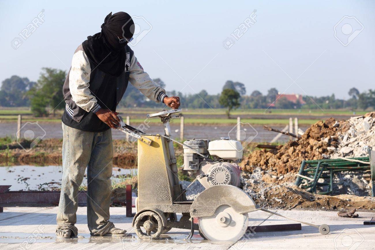 Concrete Joint cutting on new road surface Stock Photo - 17096086