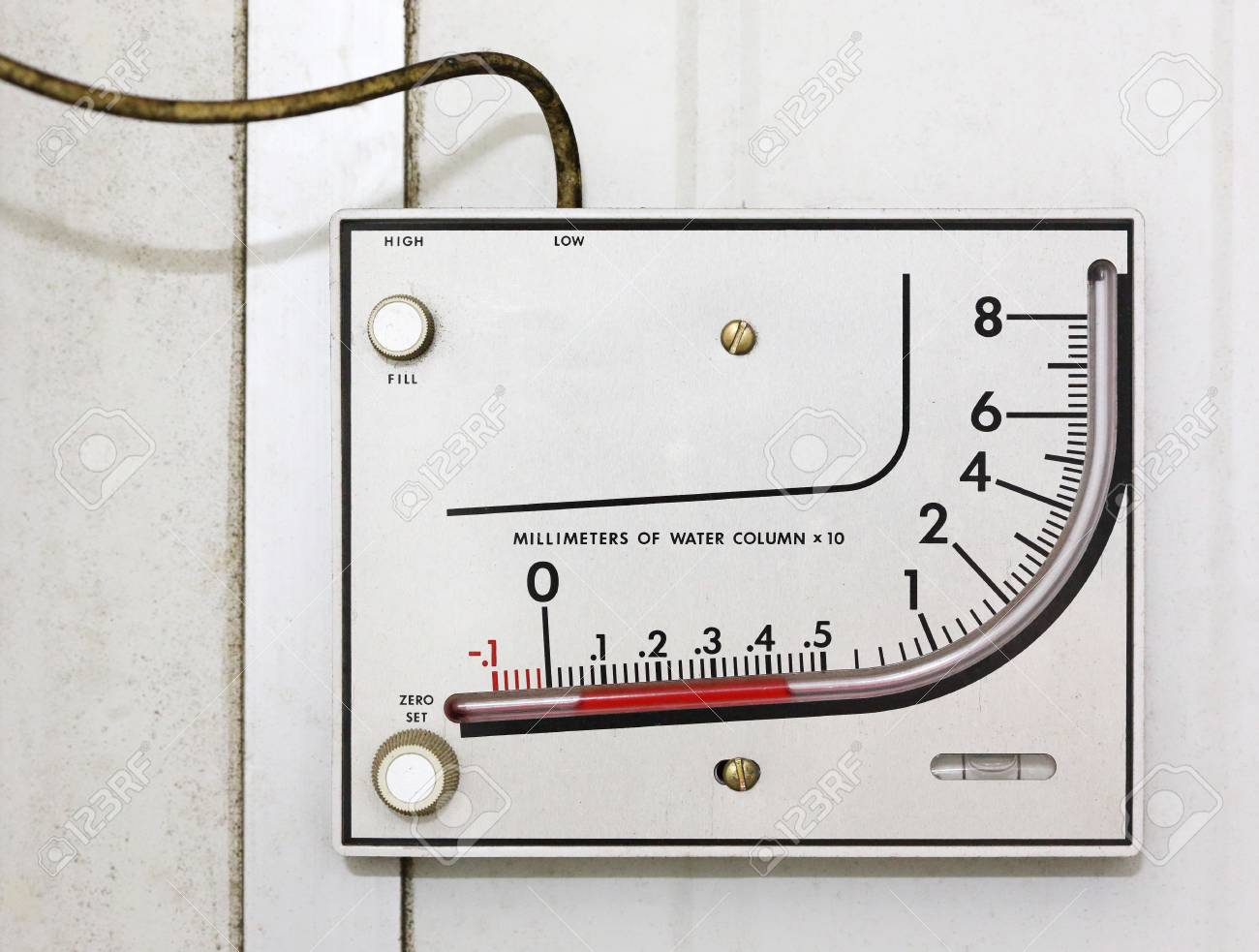 Old manometer installing on white wall Stock Photo - 17096073