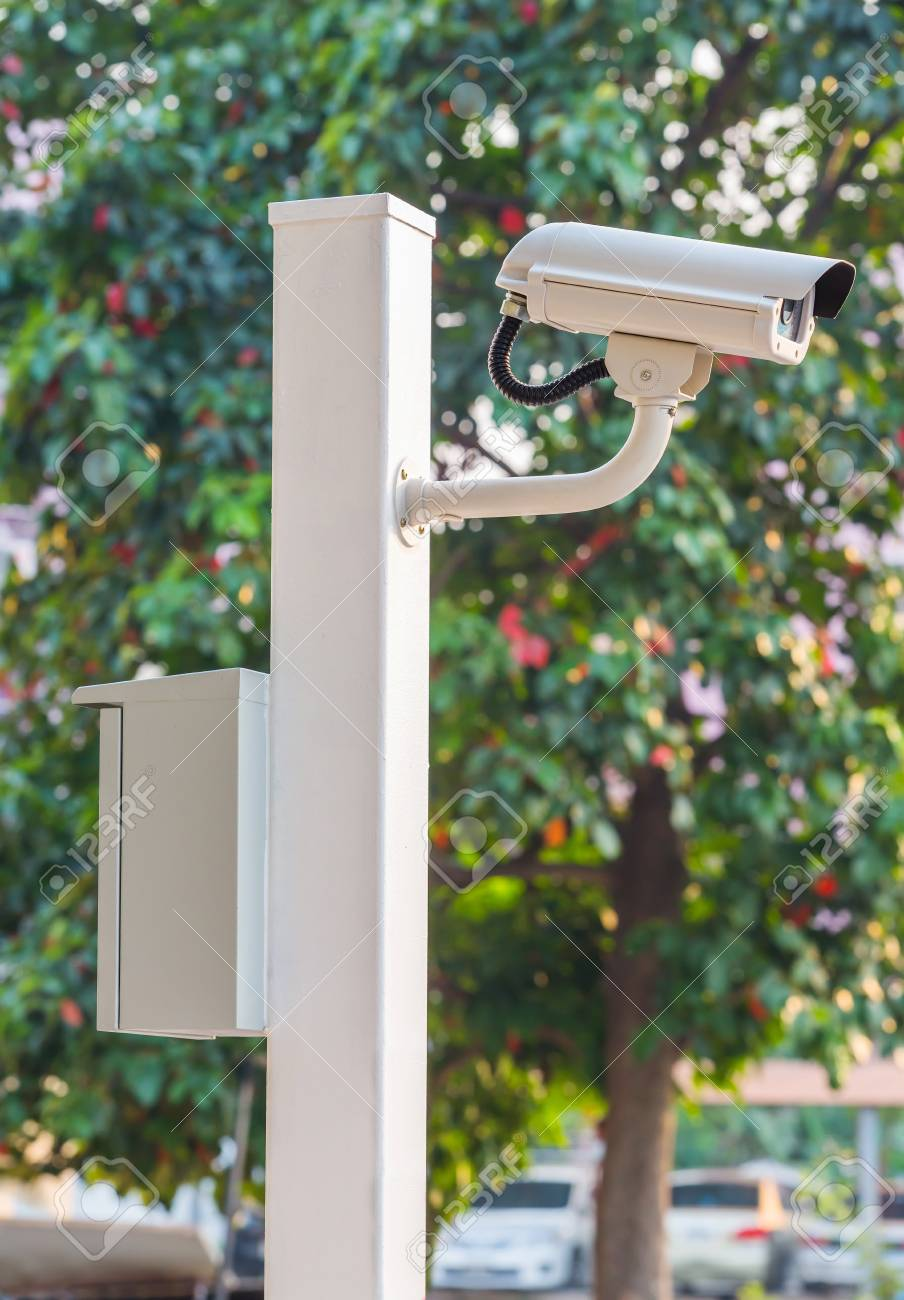 White CCTV camera watching for security 24 hours Stock Photo - 17568359
