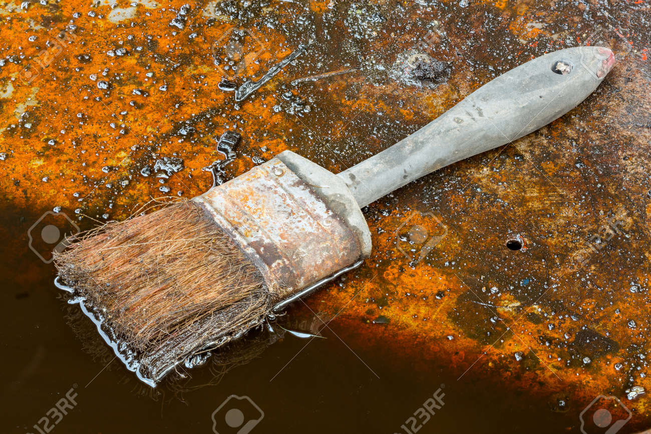 Dirty used oil and brush in garage Stock Photo - 17921261