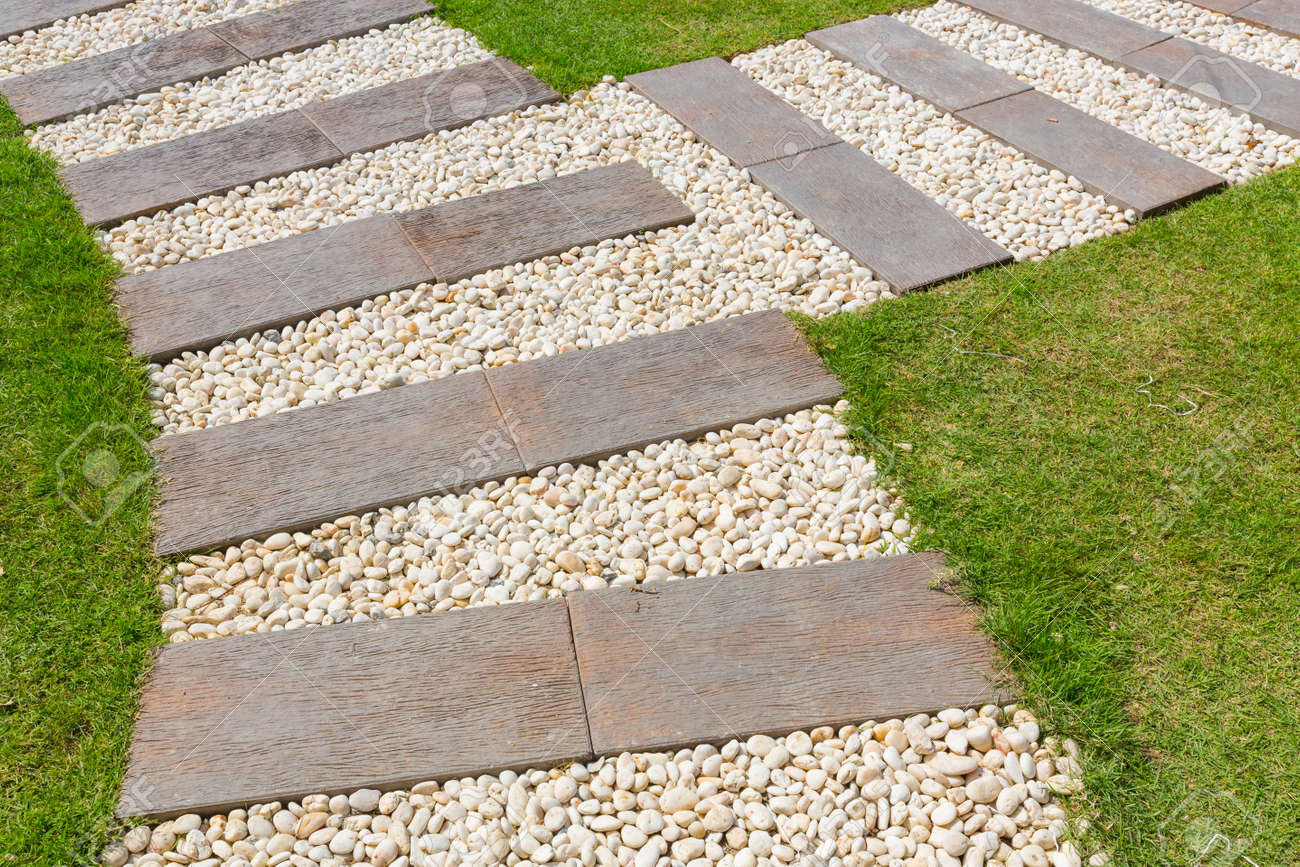 Beautiful Stone And Wood Path In Garden Stock Photo   20322138
