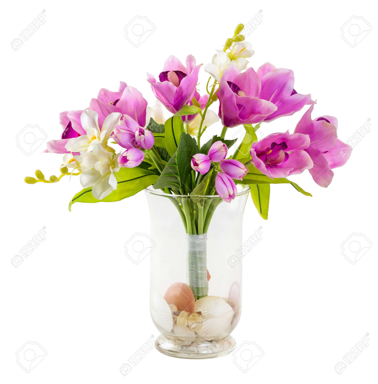 Bouquet of tulip and orchid in glass vase decorated with stone bouquet of tulip and orchid in glass vase decorated with stone and sea shell isolated on reviewsmspy