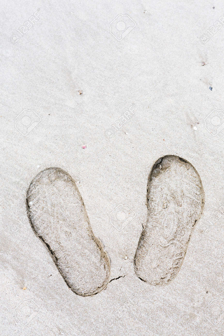Close up shoe prints in the beach Stock Photo - 21372576
