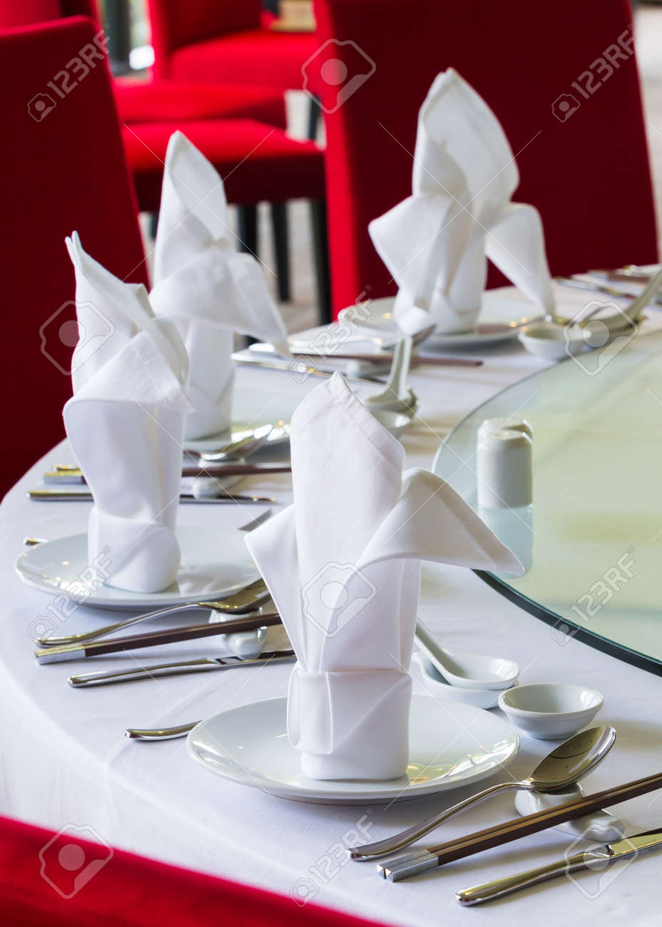 close up white napkin on chinese dining table set up stock photo