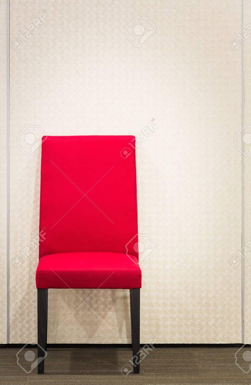 Red elegance chair on carpet floor near metal wall Stock Photo - 21372711