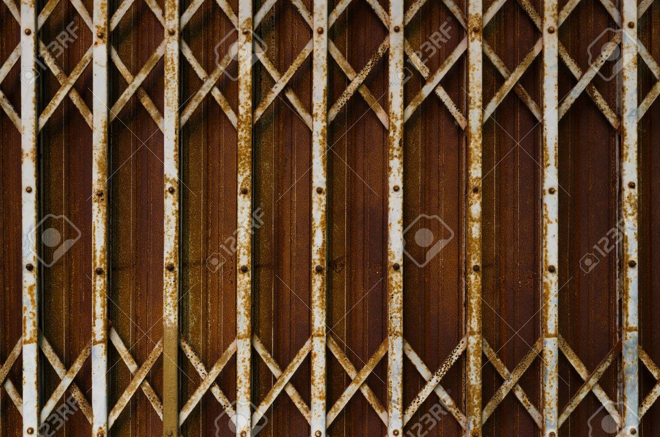 Rusty Steel Collapsible Door Texture, Old Fashion Style Shutter Gate Stock  Photo   51776217
