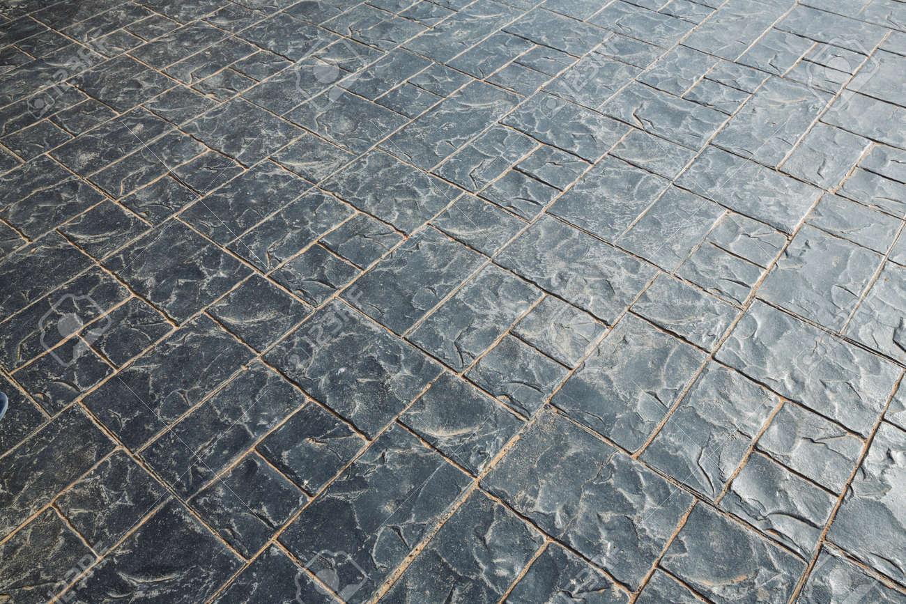 Graue Farbe Rohstein Bodenfliesen Hintergrund Aussenboden