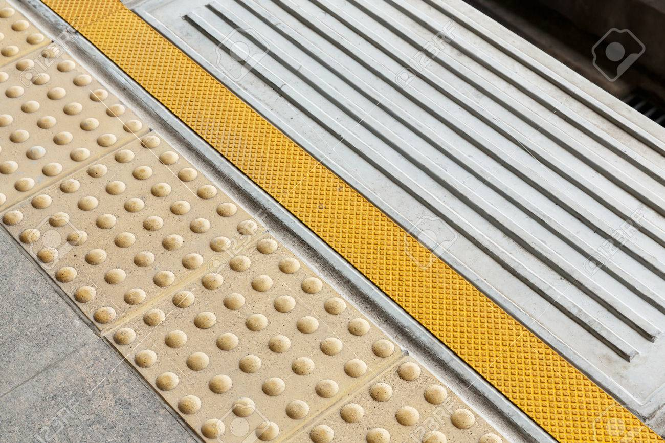 Blind floor tiles on train station platform modern urban blind floor tiles on train station platform modern urban lifestyle concept stock photo 75731286 dailygadgetfo Image collections