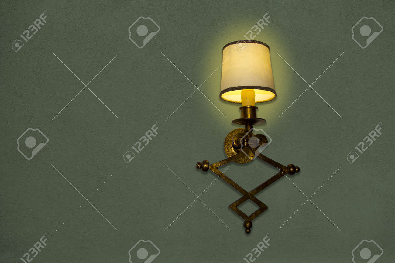 old wall lamp made of metal with shade from canvas stock photo