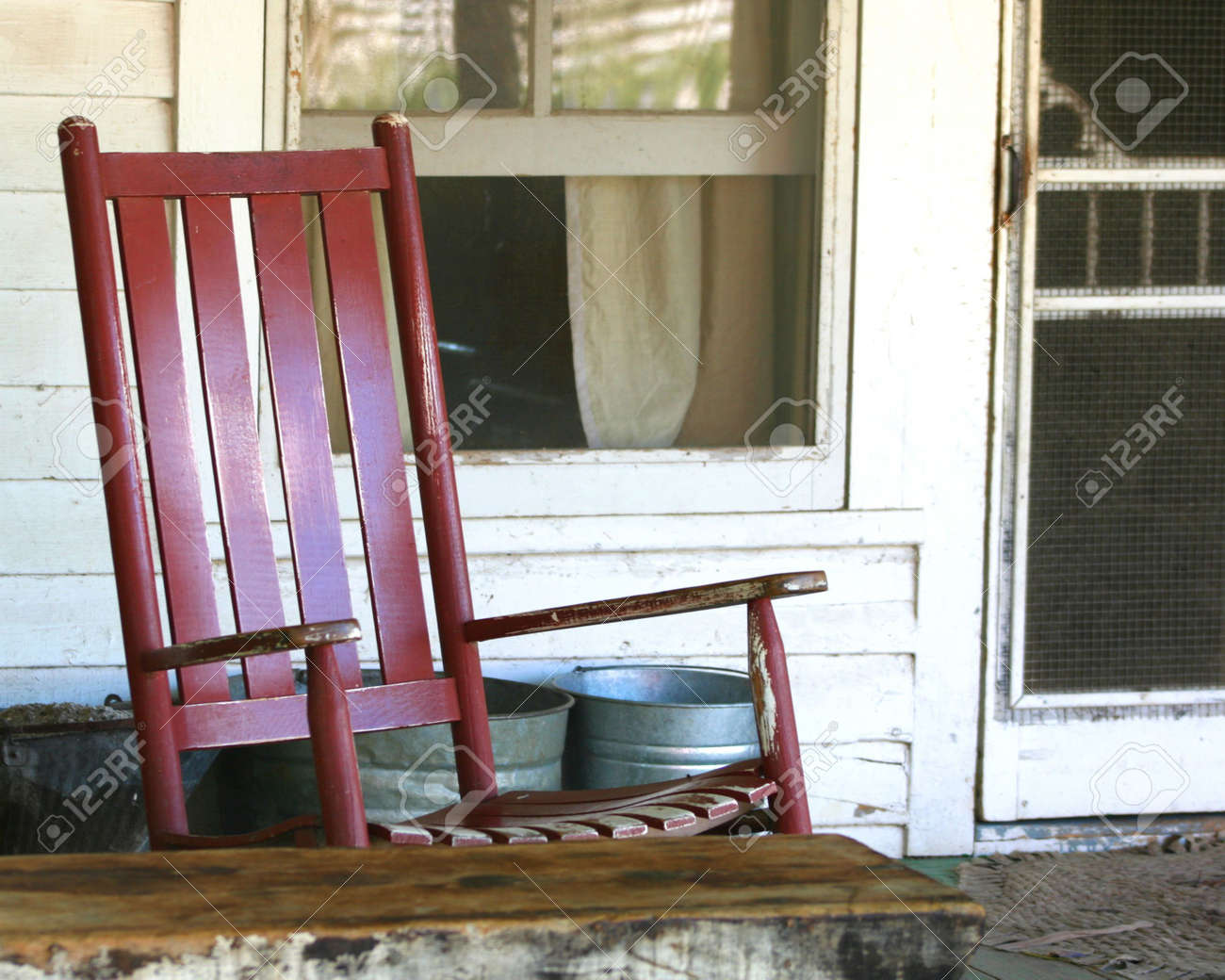 Antique porch rocking chairs - Red Rocking Chair On The Porch Of An Old Farmhouse Stock Photo 575874