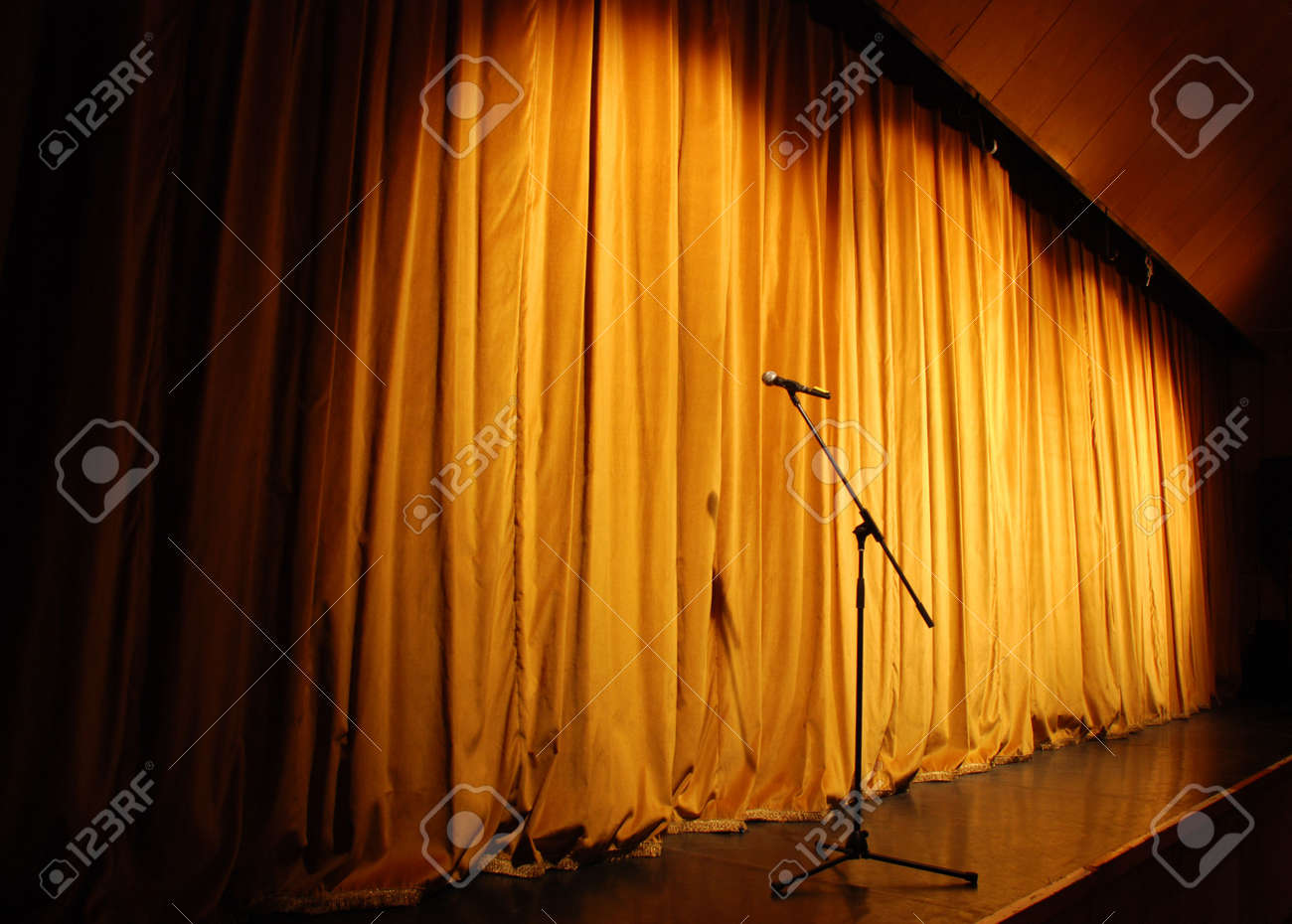 elegant theater stage, orange curtain with microphone Stock Photo - 4635263