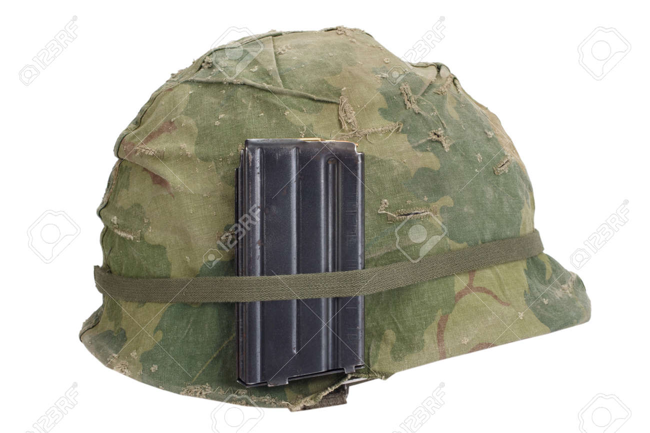 86bd79fb Stock Photo - US Army helmet Vietnam war period with camouflage cover,  magazine with ammo isolated on white