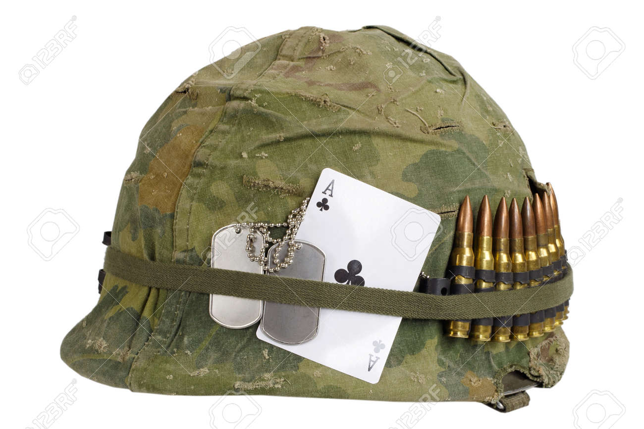 US Army helmet Vietnam war period with camouflage cover and ammo