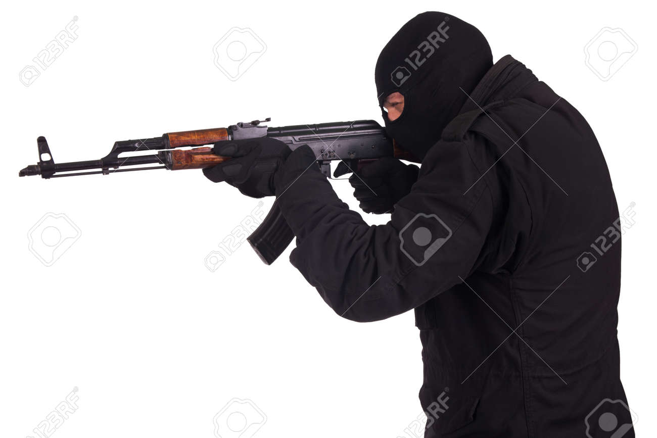 man in black uniform and mask with AK 47 gun isolated on white