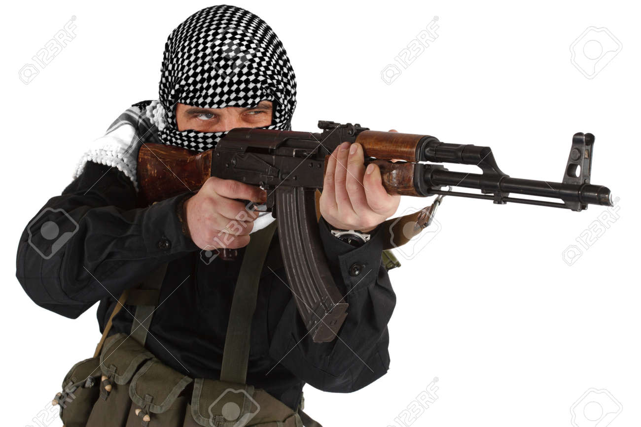 insurgent dressed in black uniform and black and white shemagh with AK 47 rifle isolated on white - 126102916