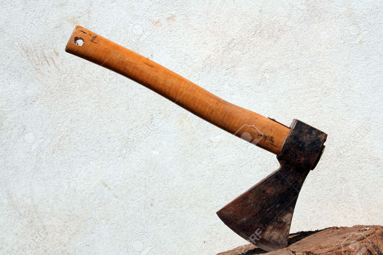 old ax stuck in a strain of wood Stock Photo - 9656478