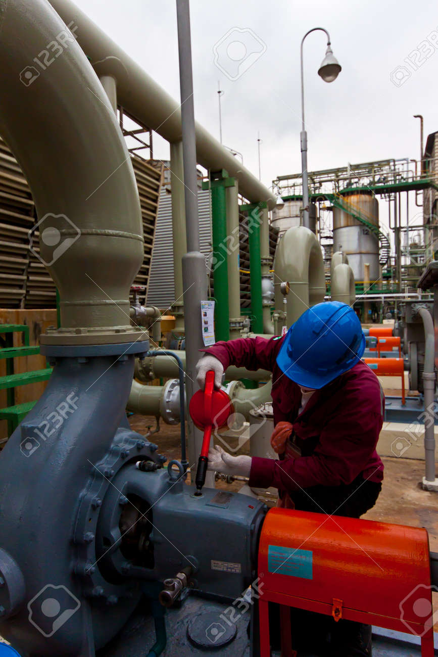 man at work filling oil pump in power factory Stock Photo - 12626497