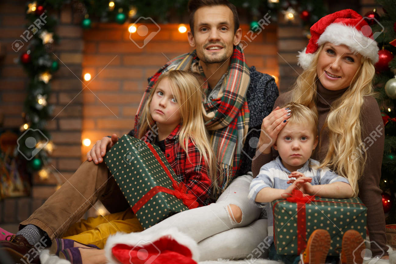family with children on background of new years interior stock photo 66441286