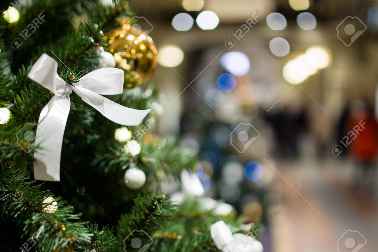 Christmas Tree Close Up On Background Of Shopping Center Stock Photo