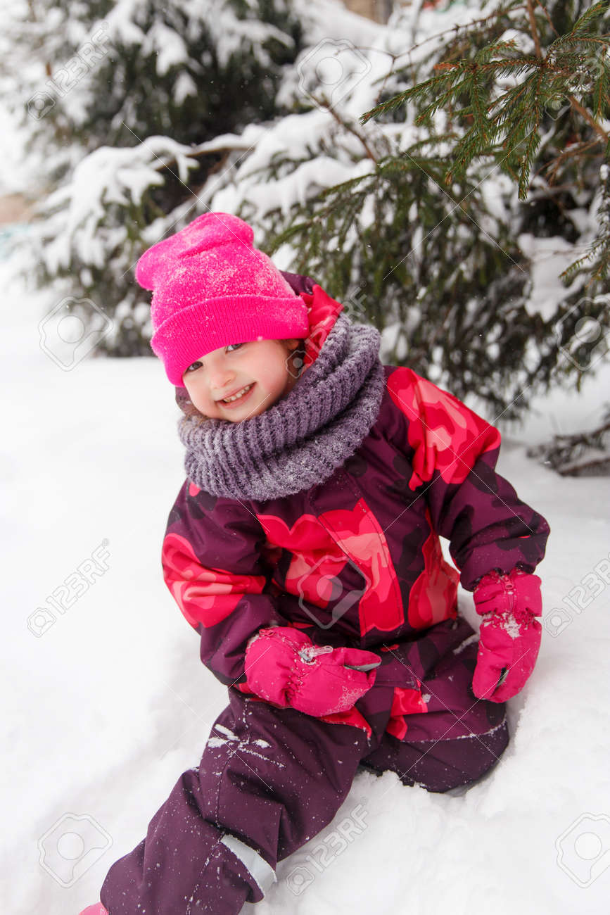 bd1d6ec5f5c8 Laughing Girl In Winter Suit Stock Photo