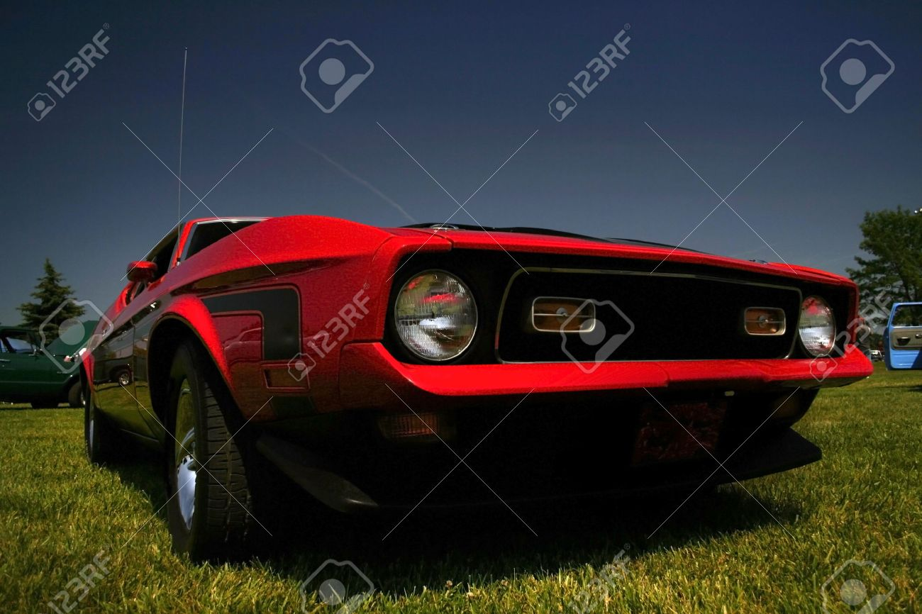 Agressive Wide Angle Shot Of Red Old Muscle Car Stock Photo, Picture ...