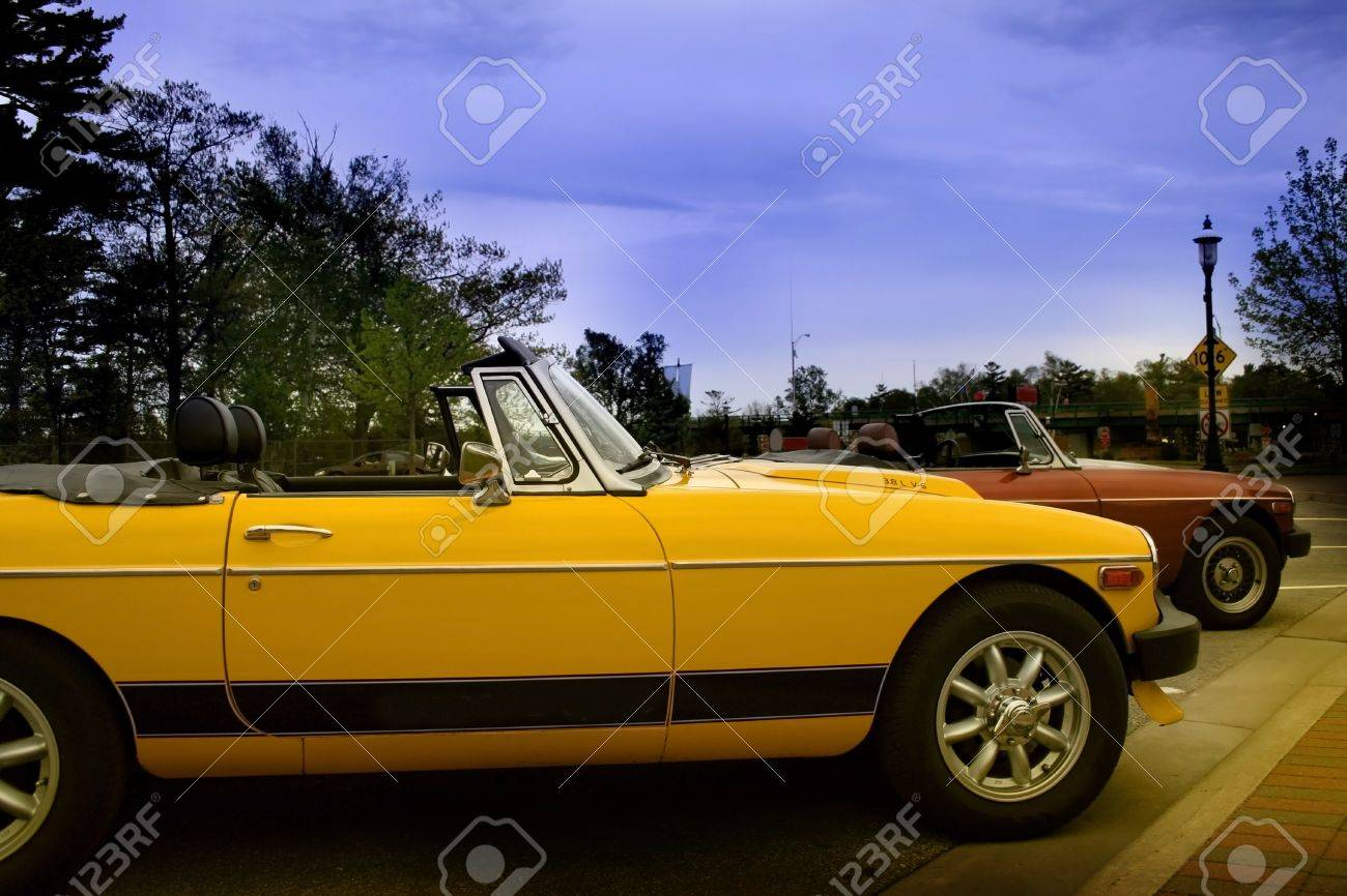 Two Old Sport Cars Parked In A Parking Lot Stock Photo, Picture ...
