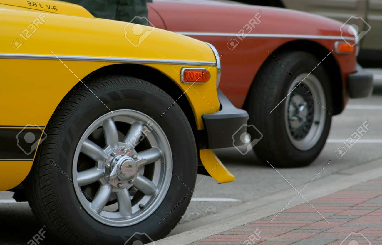 Two Old Sport Cars Parked In A Parking Lot Stock Photo, Picture And ...