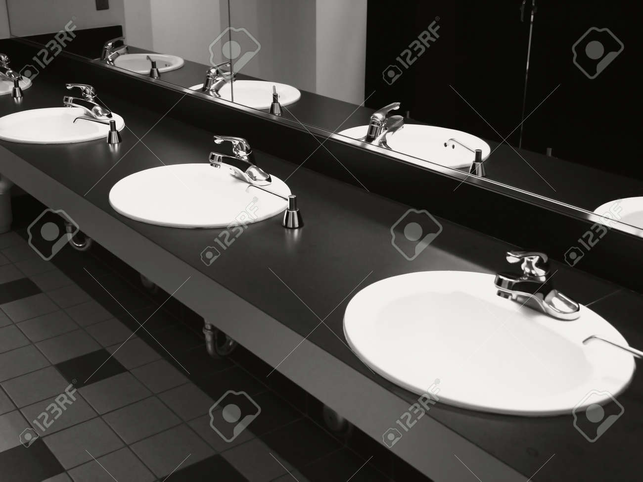 Bathroom wash basins and taps on black top Stock Photo   1717234. Bathroom Wash Basins And Taps On Black Top Stock Photo  Picture