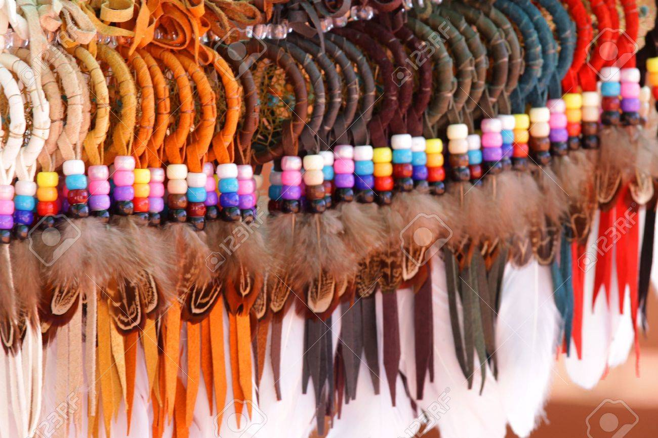 Colorful handicrafts made with bird feathers by Indians Stock Photo - 6783059