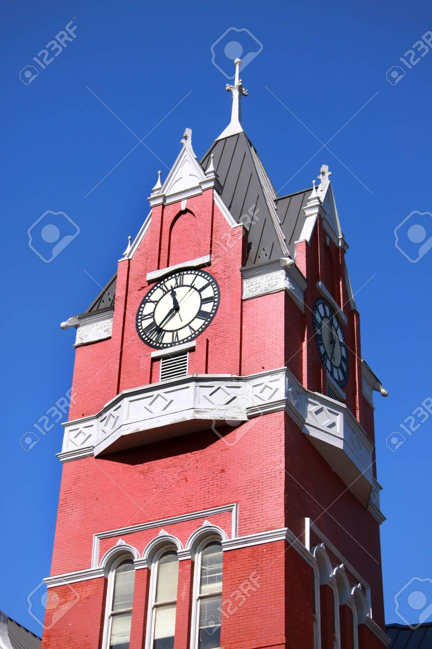 Historic clock tower against blue sky Stock Photo - 12429264