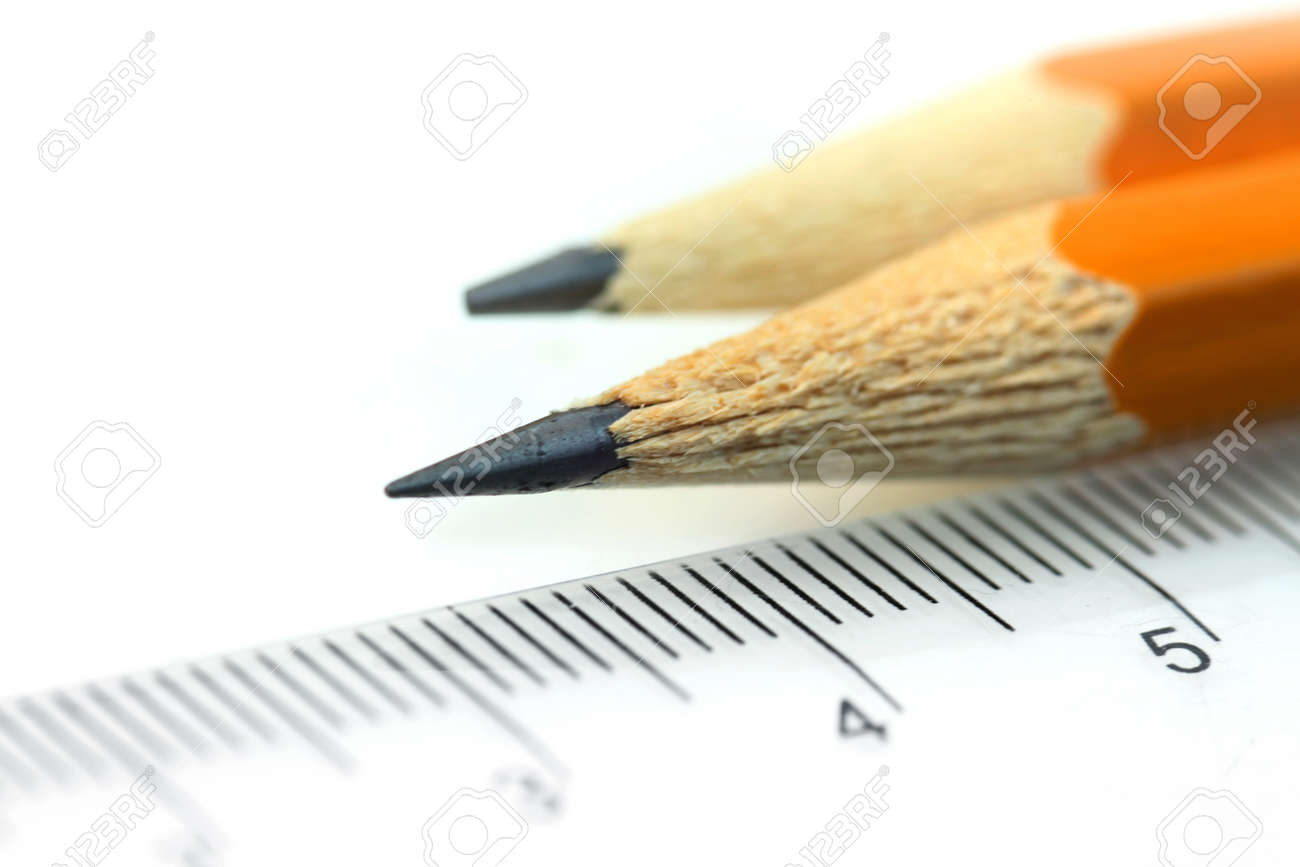 Close up shot of two sharpened pencil and scale - 15494253