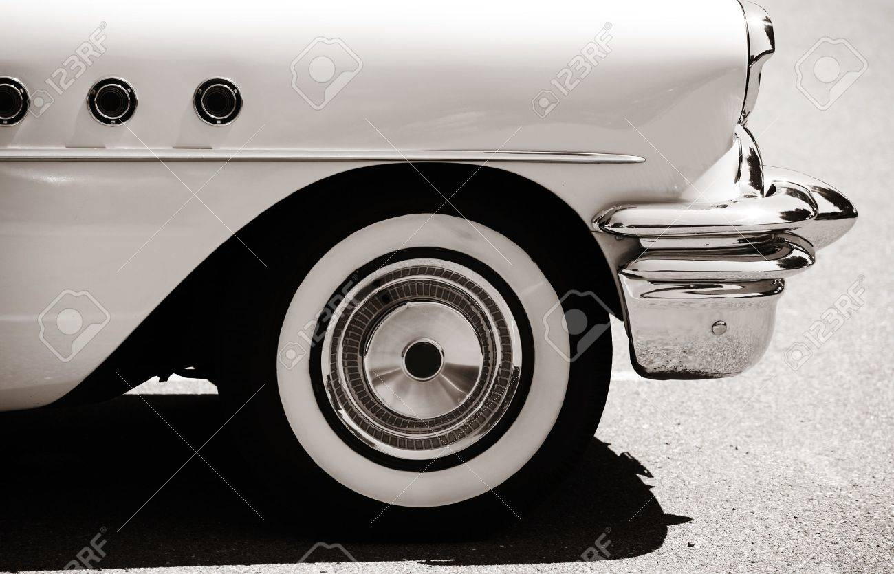 Side view of classic car with front wheel - 17068091