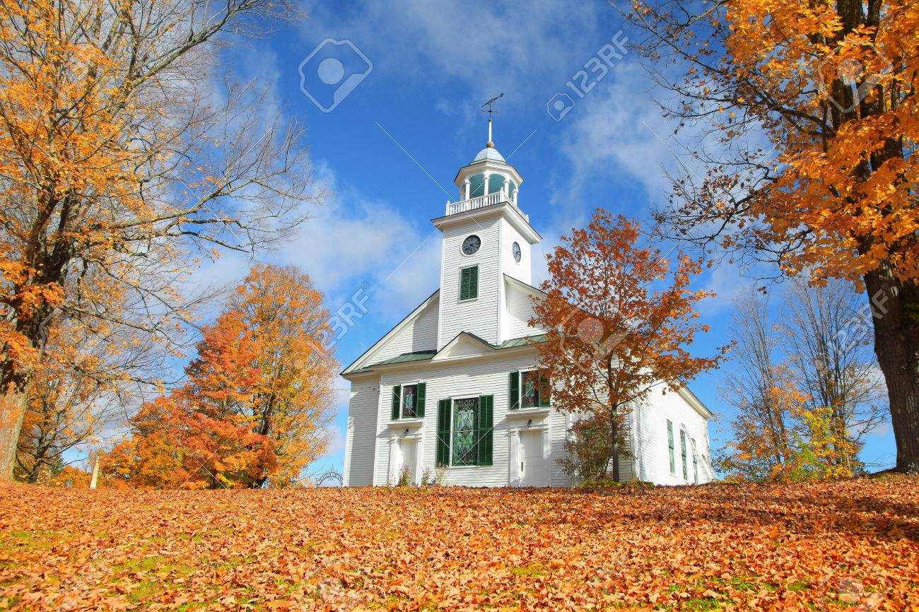 Small church in typical New England town with fall foliage - 87656960