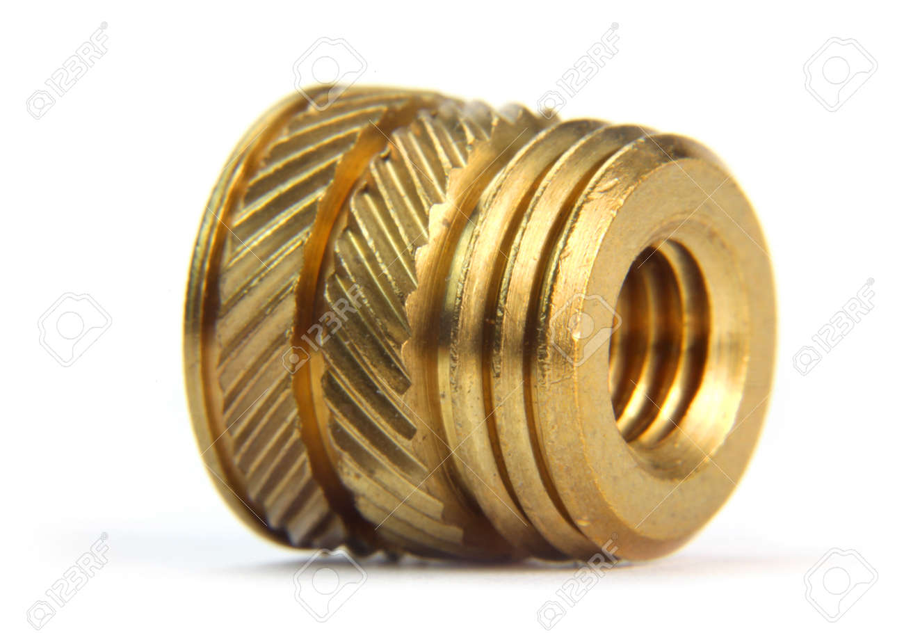 Brass threaded insert on white background