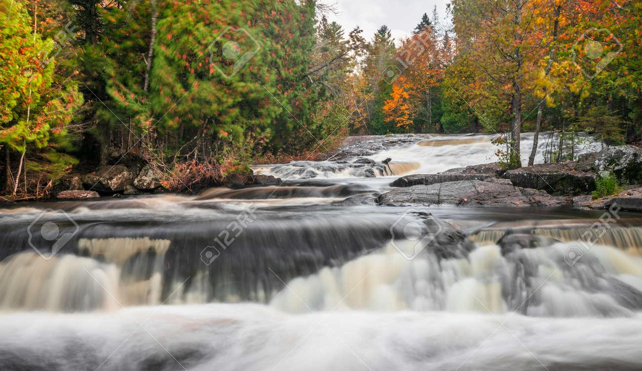 Scenic Upper Bond falls near Paulding in Michigan upper peninsula in autumn time. - 163916599