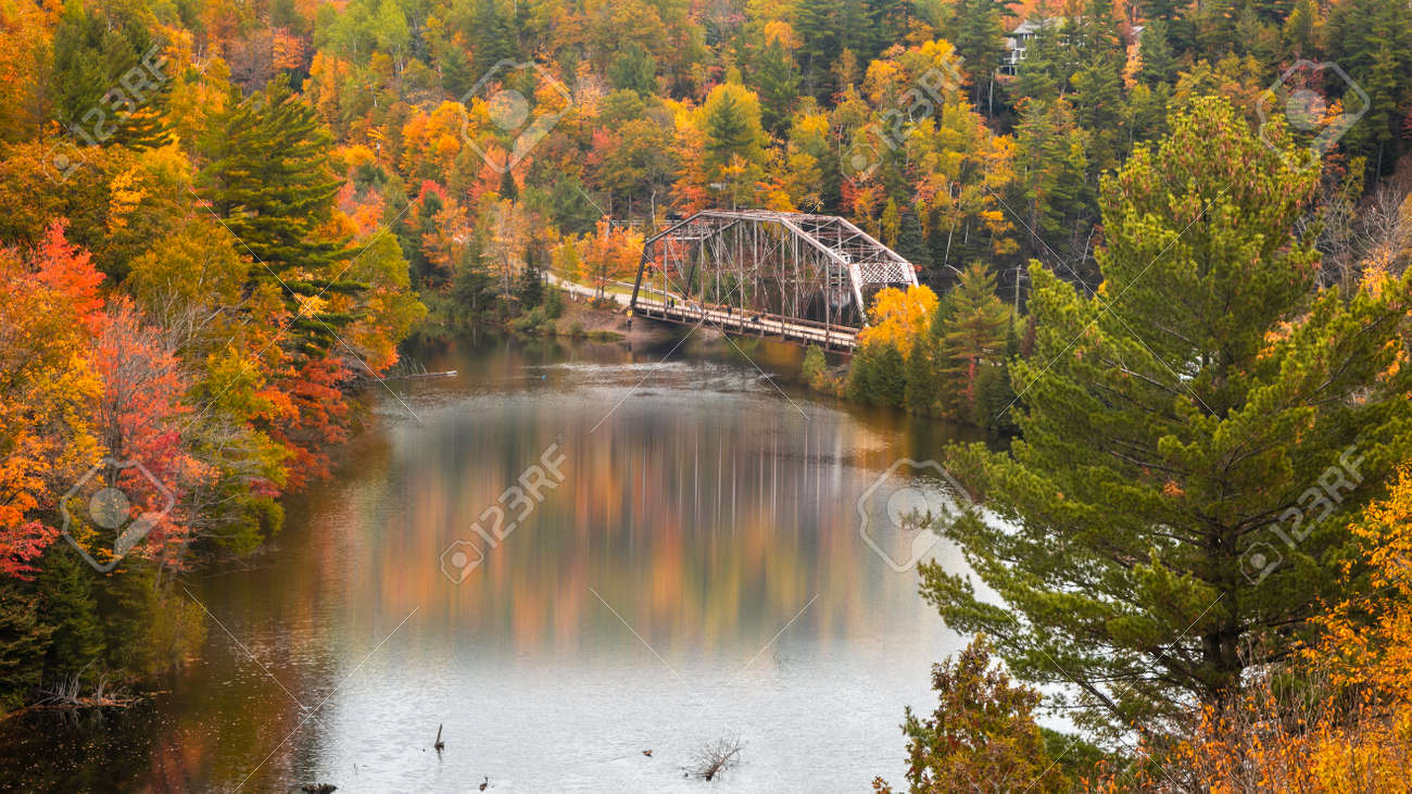 Old high way 510 bridge near Marquette city in Michigan upper peninsula during autumn time. - 164161316