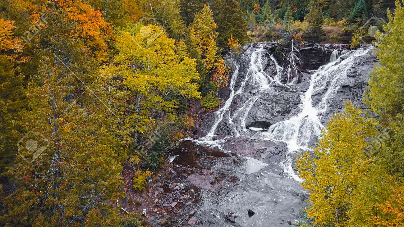 Eagle river falls in Keweenaw peninsula in Michigan upper peninsula during autumn time. - 164161348