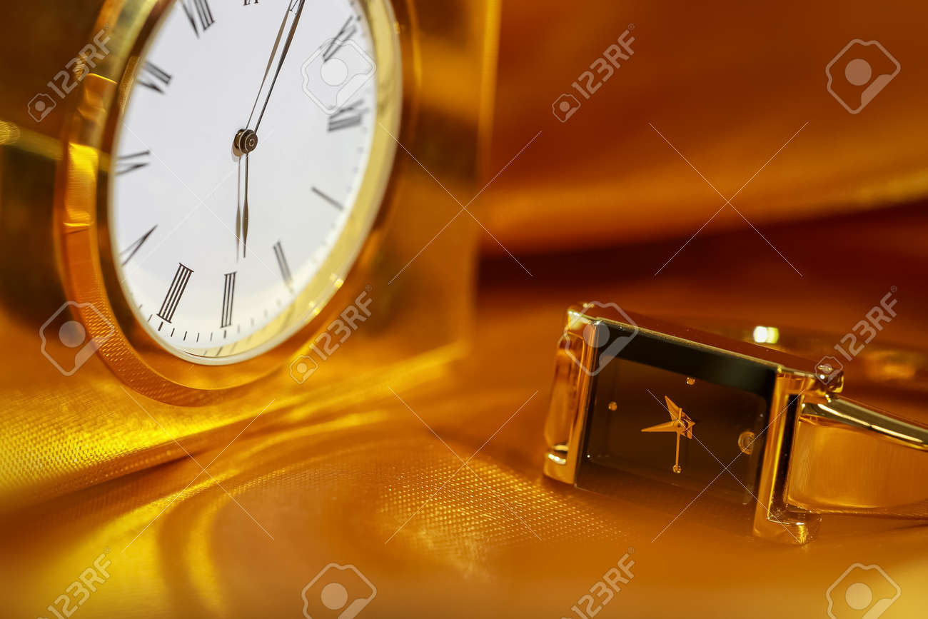 Close up shot of golden watch and clock - 164161377